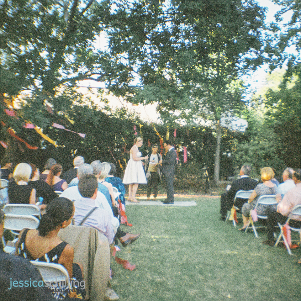 indie wedding outdoor streamers tree captured with retro vintage Lomography toy camera film