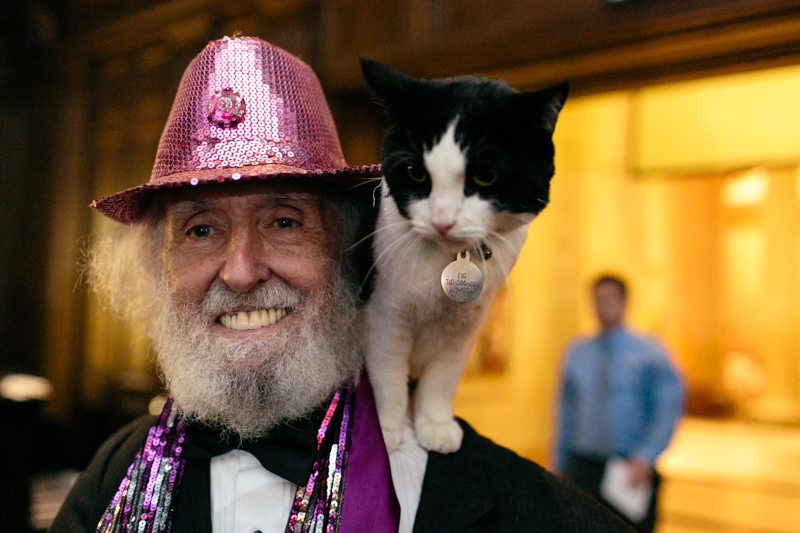 offbeat wedding magician with cat