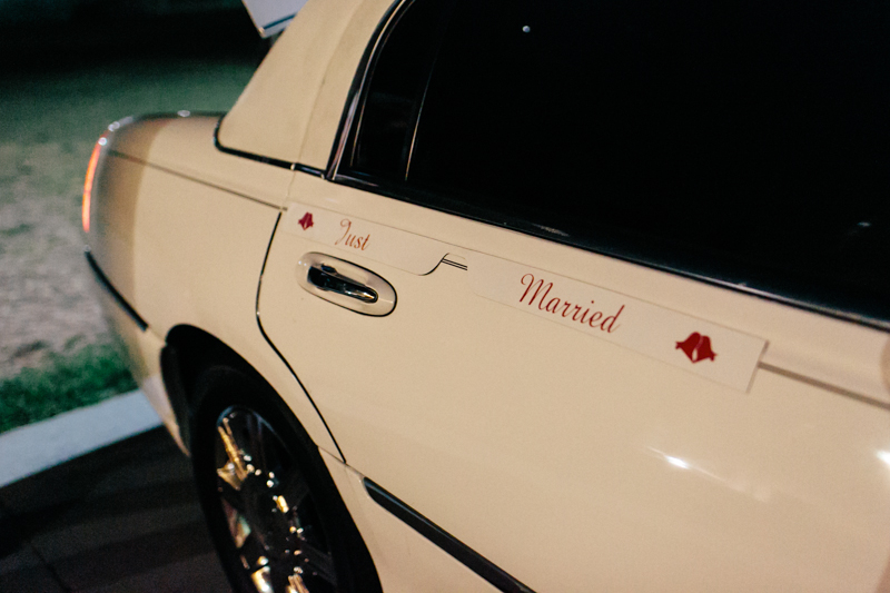 &quot;just married&quot; sign on limo at offbeat, indie wedding Los Angeles