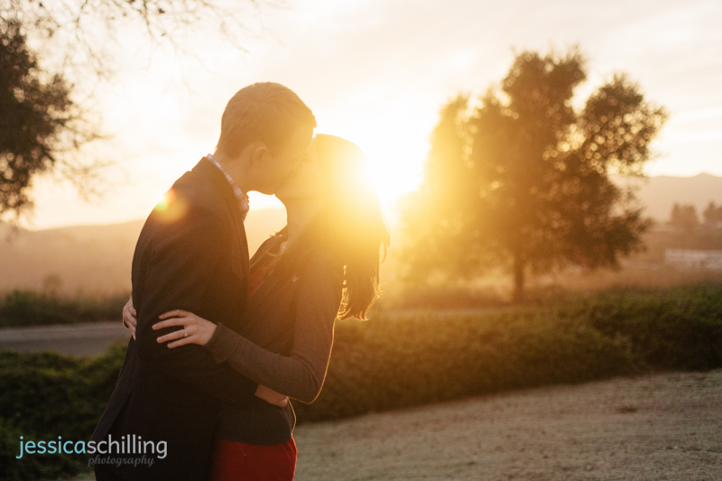 indie engagement photography couple kissing at sunset lens flare Los Angeles by Jessica Schilling