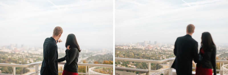 Cool indie Los Angeles engagement photos overlooking city skyline from Getty center