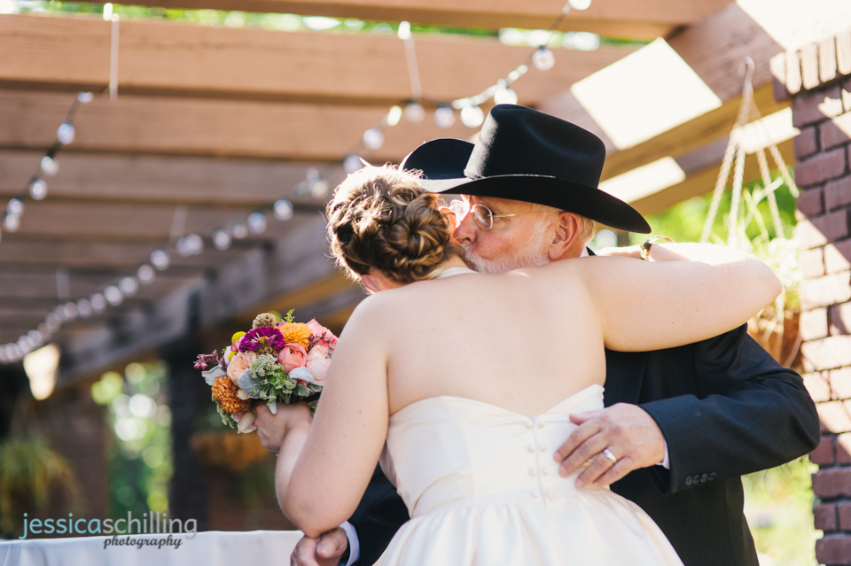 bride and father hug and kiss before indie Eagle Rock ceremony