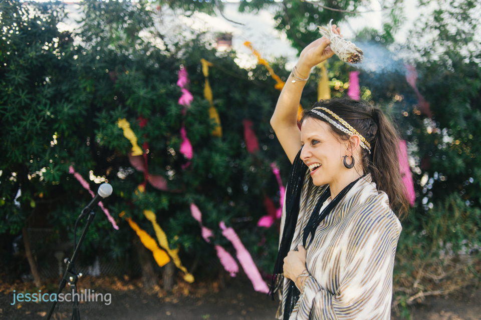 officiant burning sage before start of outdoor indie, secular wedding ceremony