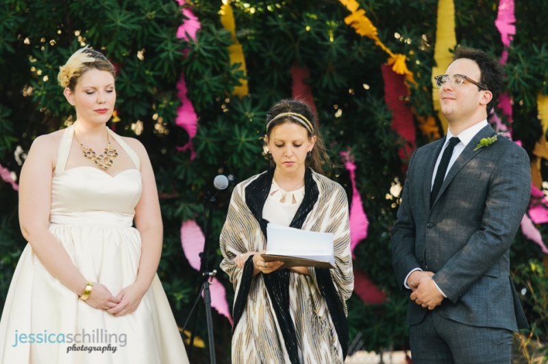 Bride and groom moment of silence with eyes closed at wedding ceremony
