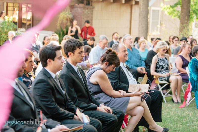 Los Angeles indie outdoor wedding ceremony with streamers