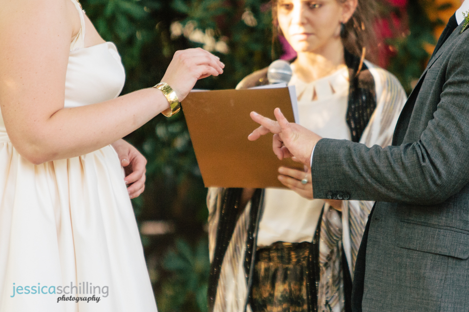 bride and groom exchange rings at indie, quirky, sweet, hipster Los Angeles wedding