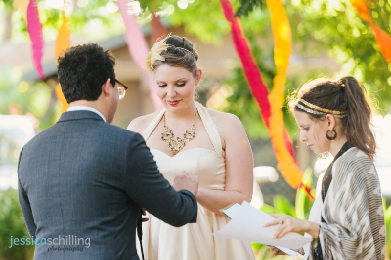 Outdoor wedding ceremony Los Angeles with paper streamer garlands