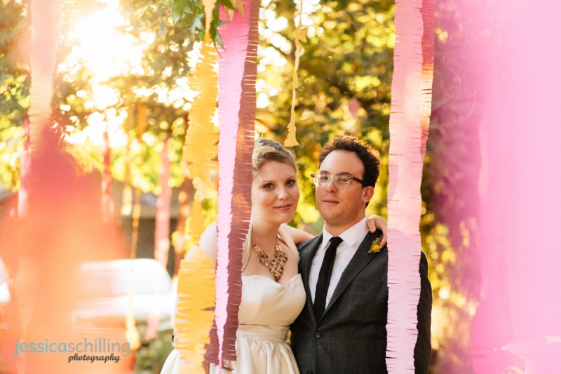 Indie, quirky, hipster bride and groom wedding portraits with streamers