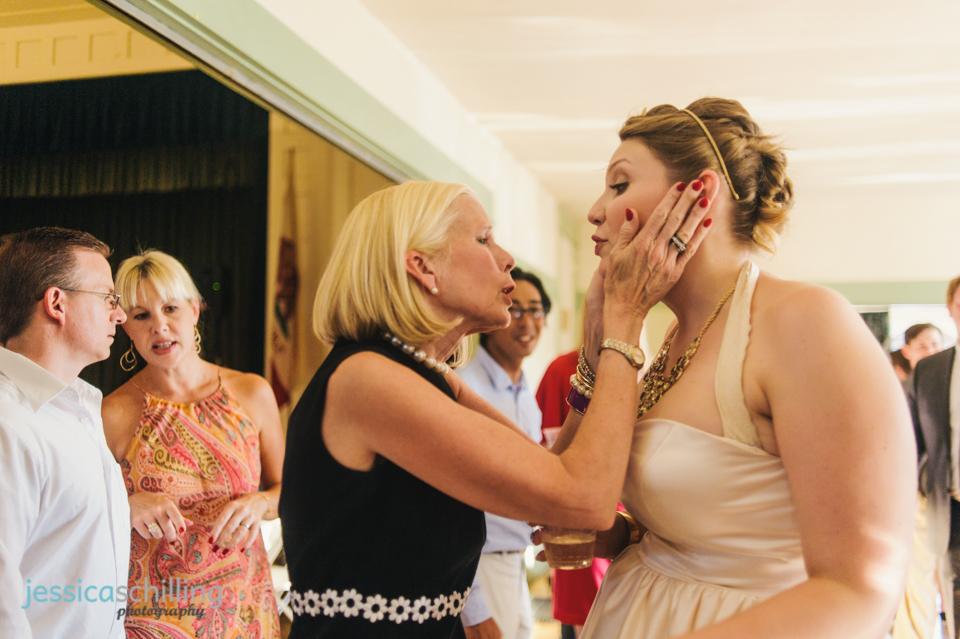 guests squeeze bride's cheeks at indie LA Eagle Rock wedding