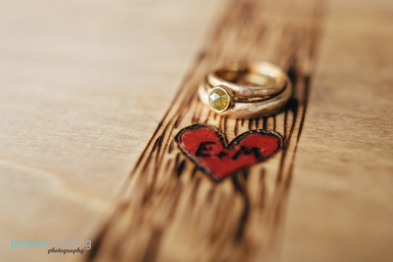indie wedding rings on handcarved guestbook