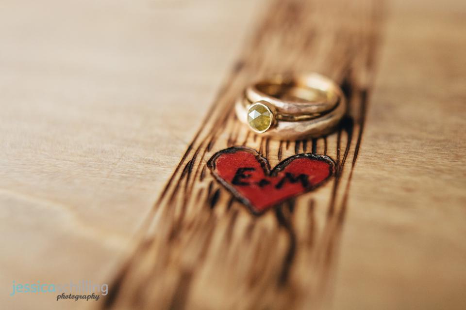 indie wedding rings on handcarved guestbook
