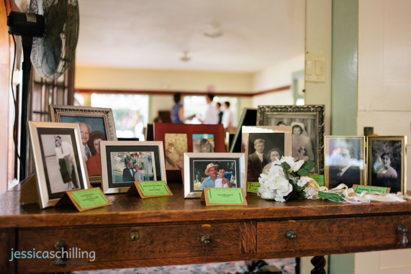 memorial photos of family members framed for display at wedding