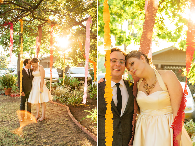 Bride and groom portraits at indie wedding with pretty colorful streamers