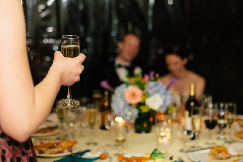 Los Angeles wedding photographer toasts champagne.