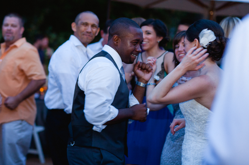 Night time outdoor wedding reception dancing at Rancho Santa Ana in Claremont