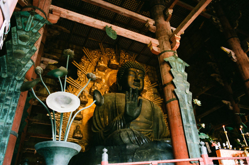 Giant golden buddha statue in Todaiji Temple in Nara Japan