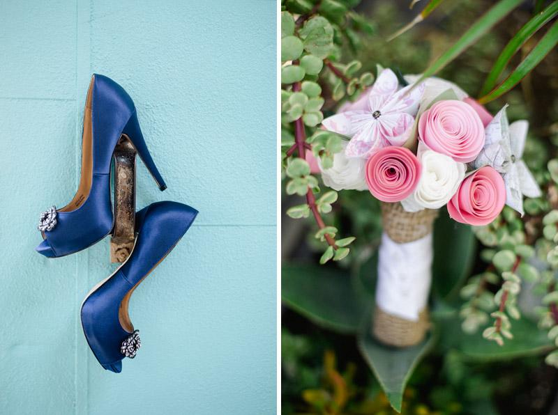 Blue bridal shoes hang off aqua door, pink paper flowers bridesmaid bouquet