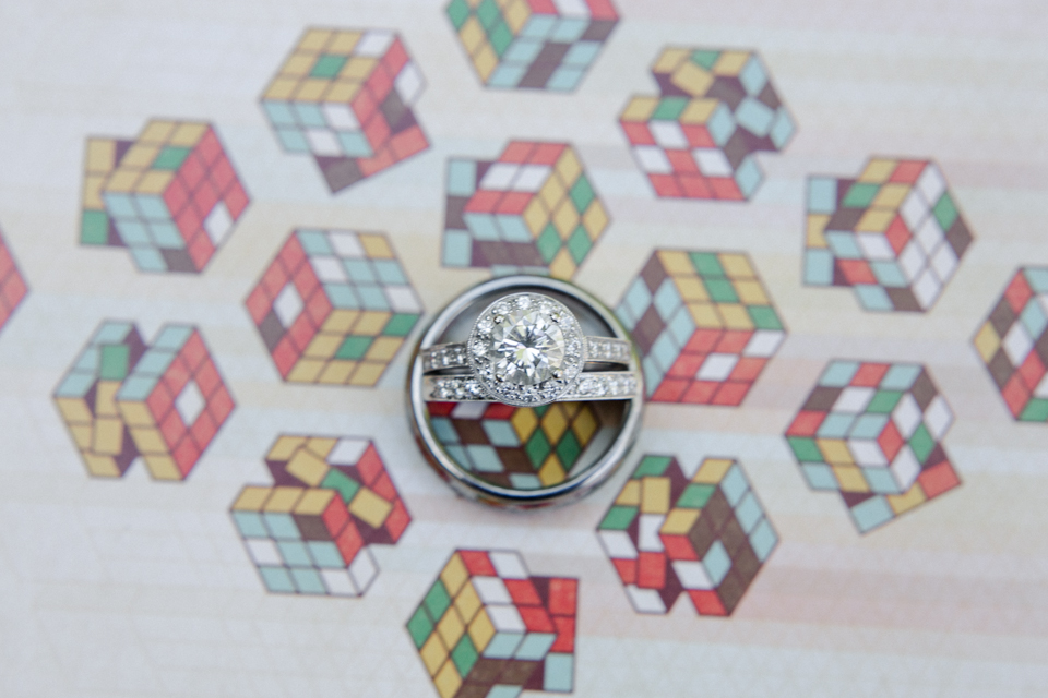 modern fun quirky wedding rings on rubiks cube postcard in Los Angeles