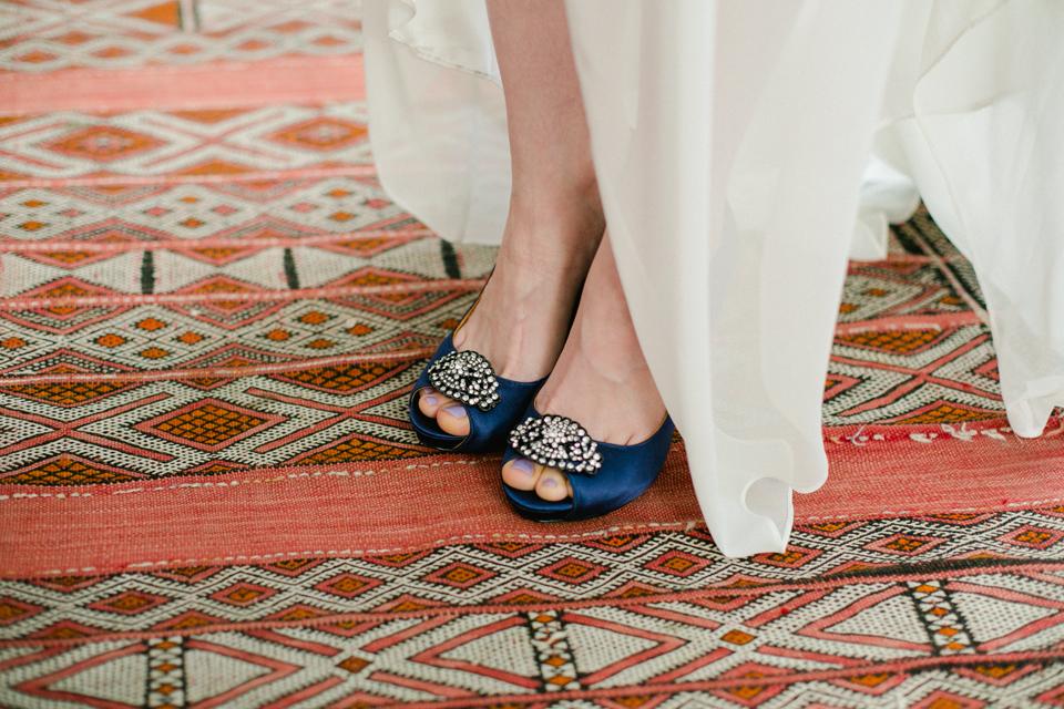 Badgley Mischka peep toe navy heels on bohemian rug at indie LA wedding venue Elysian