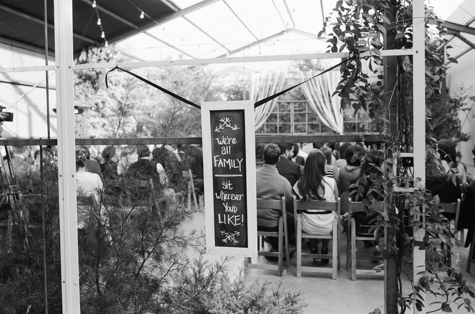 Modern Los Angeles wedding photography. Indie wedding sign we're all family, sit wherever you'd like