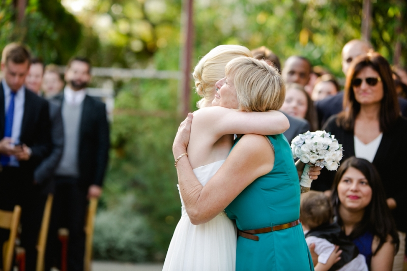 bride and mom hug during ceremony at Elysian in Los Angeles