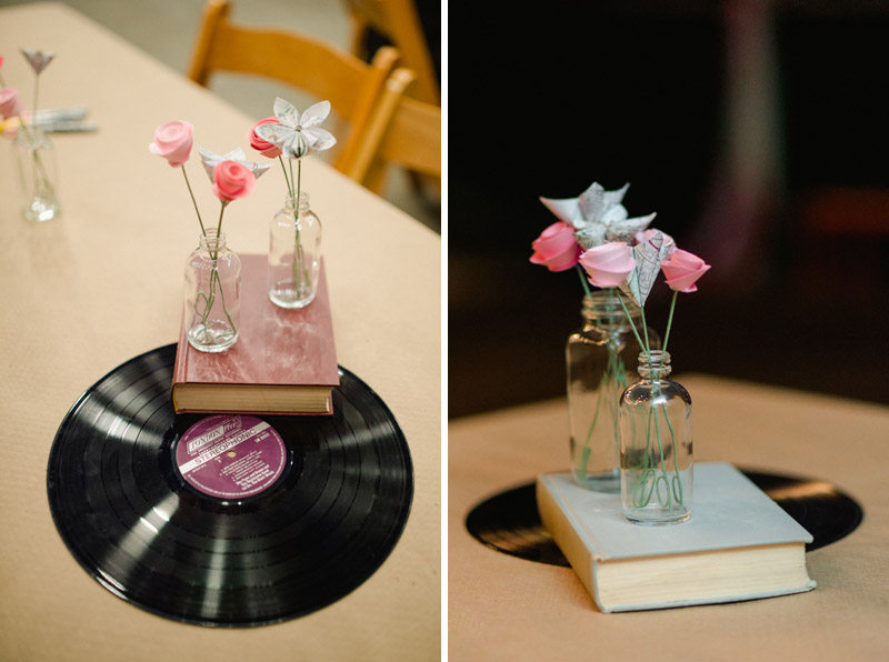 cool indie wedding reception decor with paper flowers, books, and vinyl records