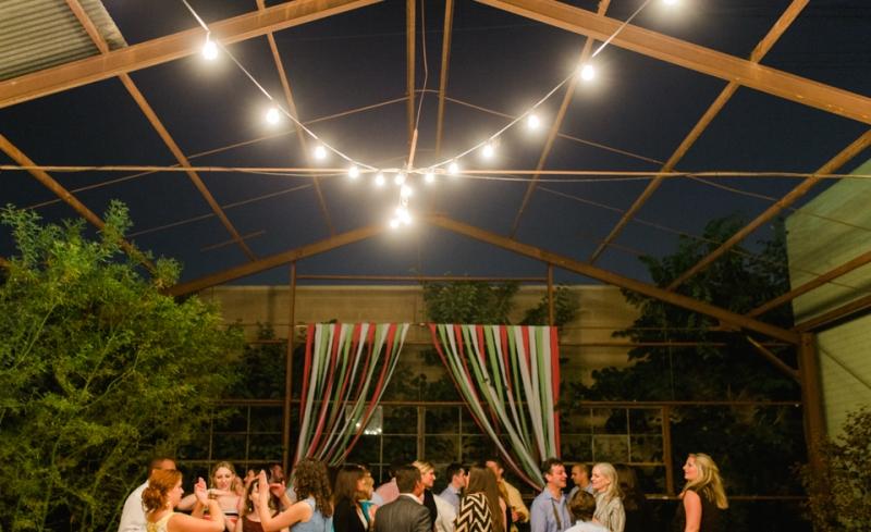 outdoor night reception with market lights over dance floor at Elysian wedding venue