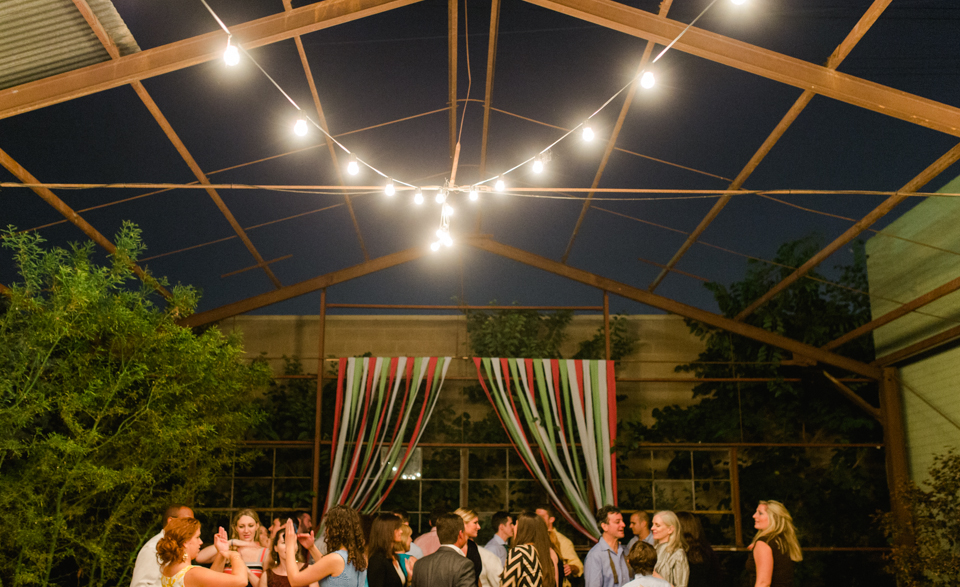 outdoor night reception with market lights over dance floor at Elysian wedding venue