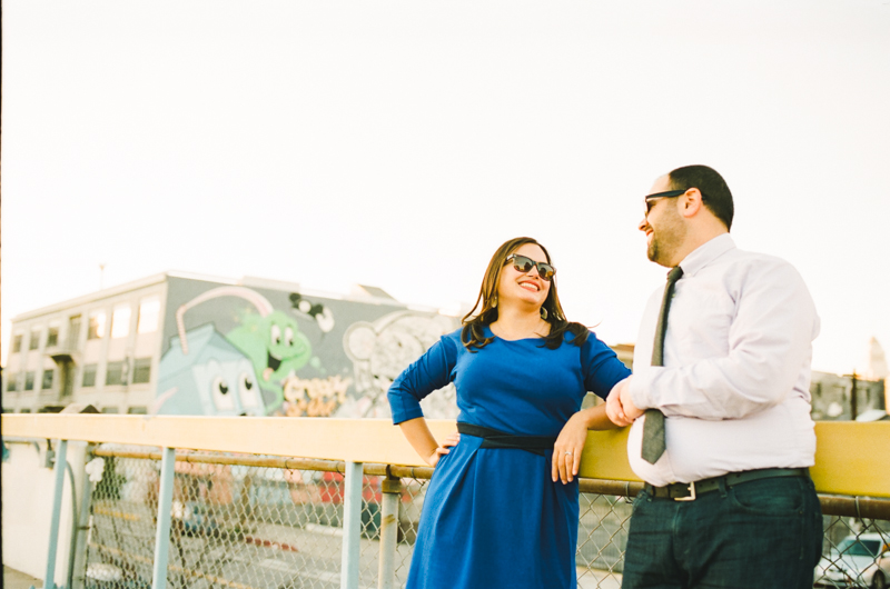 Downtown LA hipster rooftop engagement photos with sunglasses and graffiti