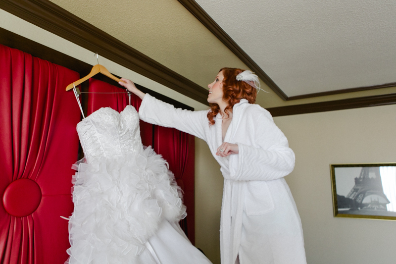 Paris Hotel bride getting ready in custom feather dress
