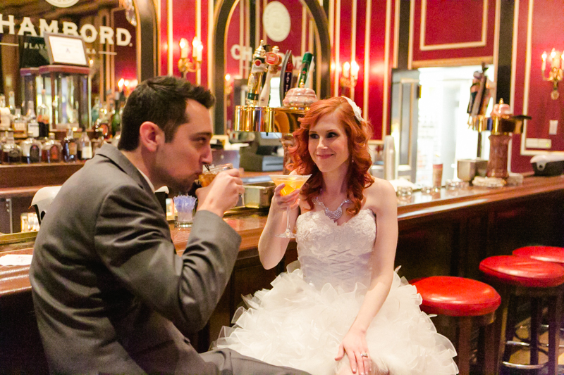 bride and groom toast with drinks