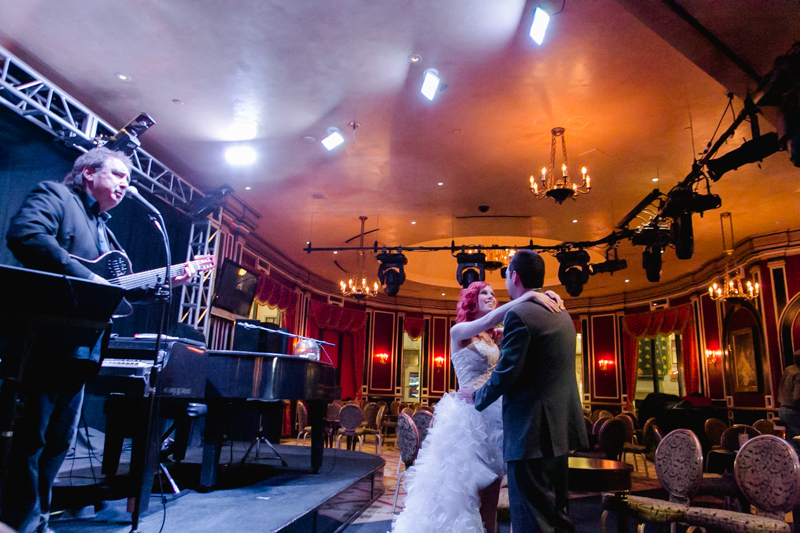 Bride and groom dance to live music serenade