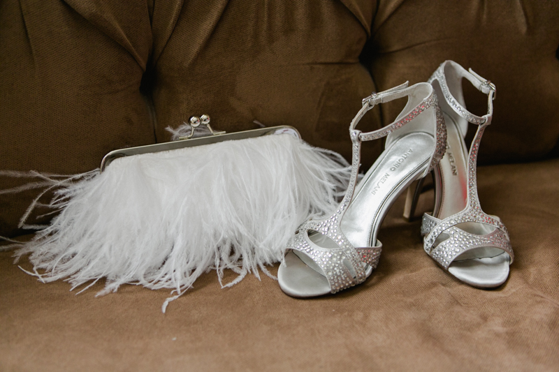 Paris hotel Las Vegas wedding details silver shoes and white feather clutch
