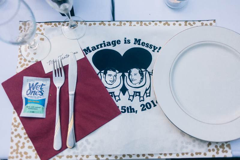 Custom designed bibs and wet naps with place settings for BBQ wedding dinner