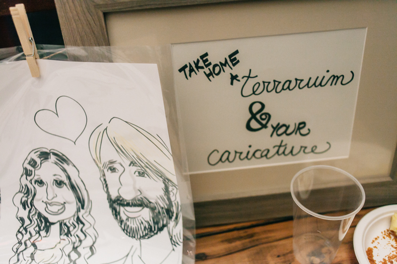 Indie wedding with caricature artists for guests entertainment