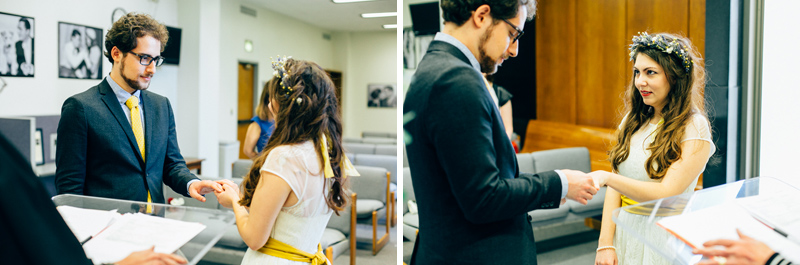 Courthouse elopement bride and groom exchange rings
