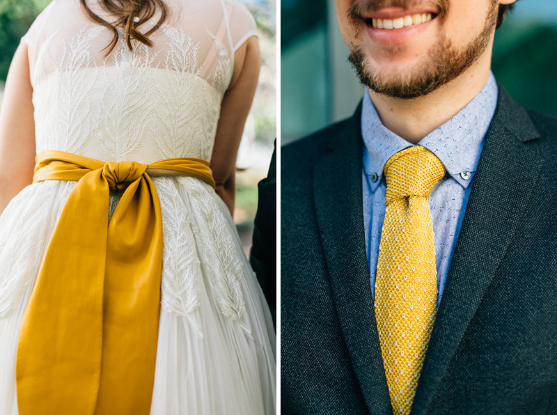 Groom with yellow tie, bride with leather obi sash and lace dress