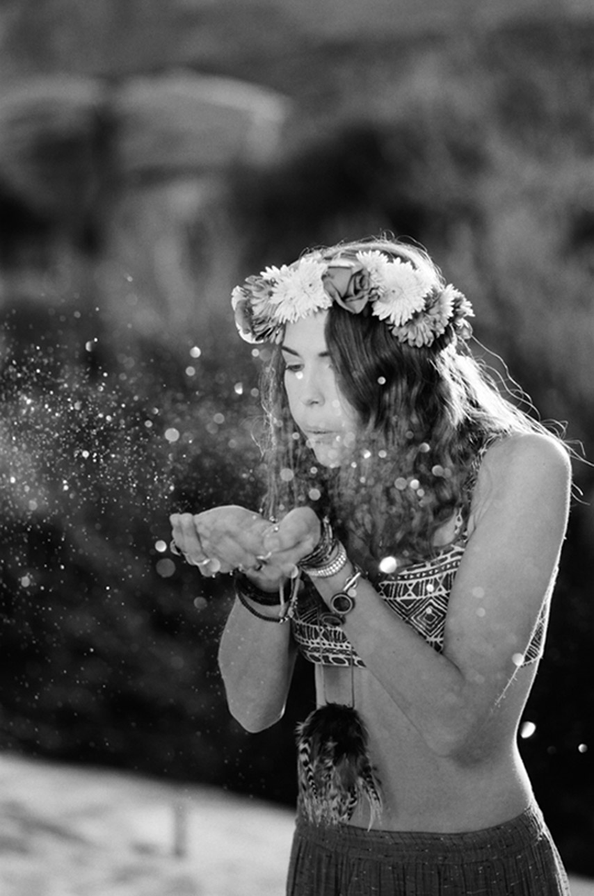 Magical gold glitter at desert fashion shoot on black and white film