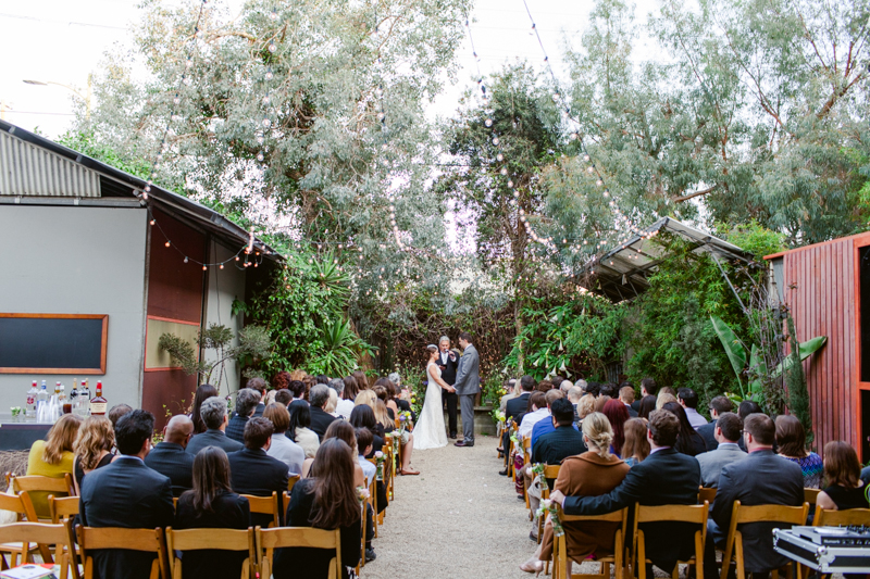 Huron Substation courtyard wedding ceremony. Similar to venues like Smog Shoppe or Marvimon House.