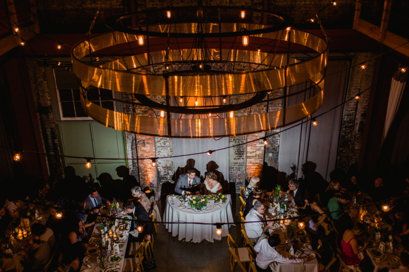 Copper chandelier at modern loft wedding reception Huron Substation