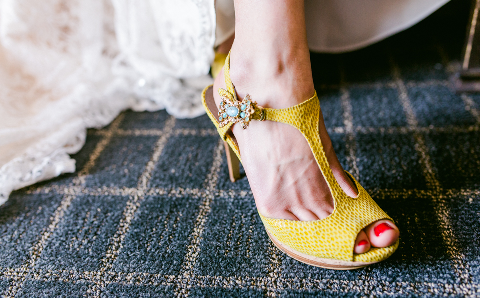 bridal yellow heels with turquoise brooch detail