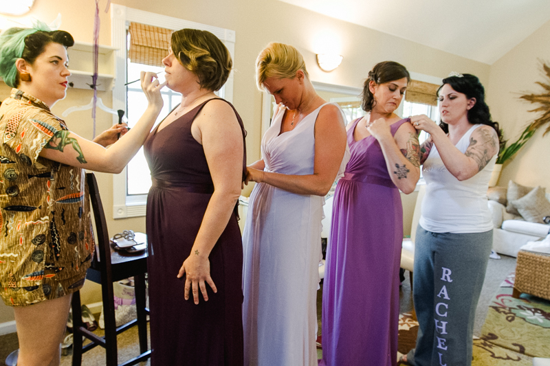 bridesmaids get ready in ombre purple dresses