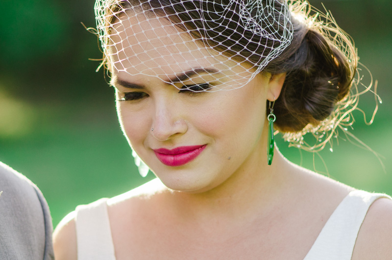 Los Angeles modern bride with bold pink lips and birdcage veil