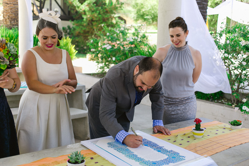 Signing the ketubah at modern colorful Jewish wedding in Los Angeles