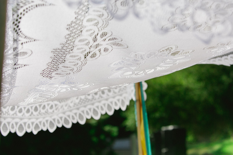 Modern Jewish wedding with lace chuppah and colorful streamers