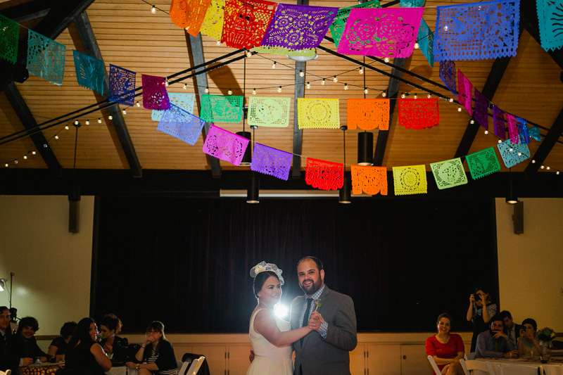 Modern Jewish wedding reception with Mexican festive colorful decorations