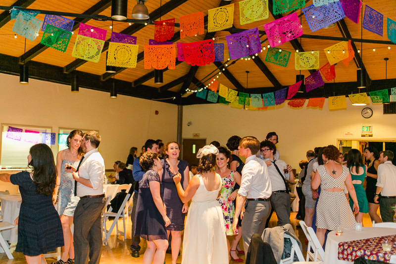 Colorful papel picado Mexican decor at modern hip DIY wedding