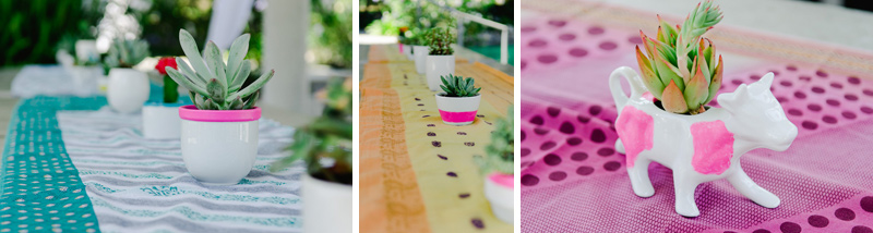 Cool California wedding decor - fabric table runners, eclectic pottery, mixed succulents
