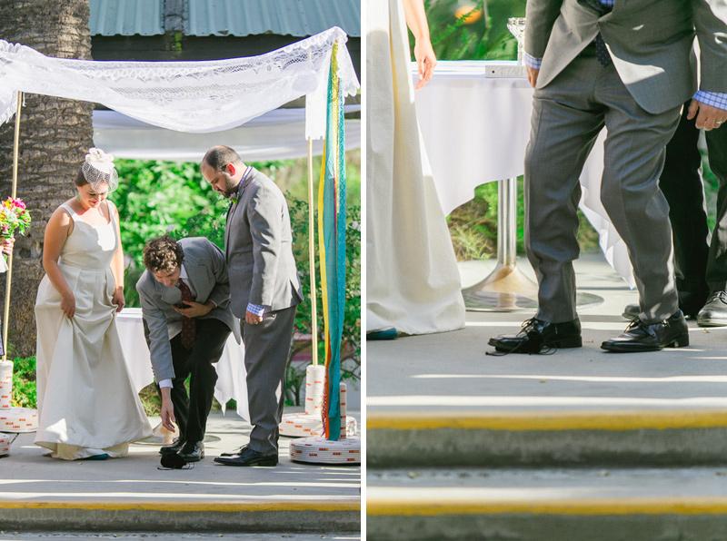 Modern colorful Jewish wedding - groom steps on glass