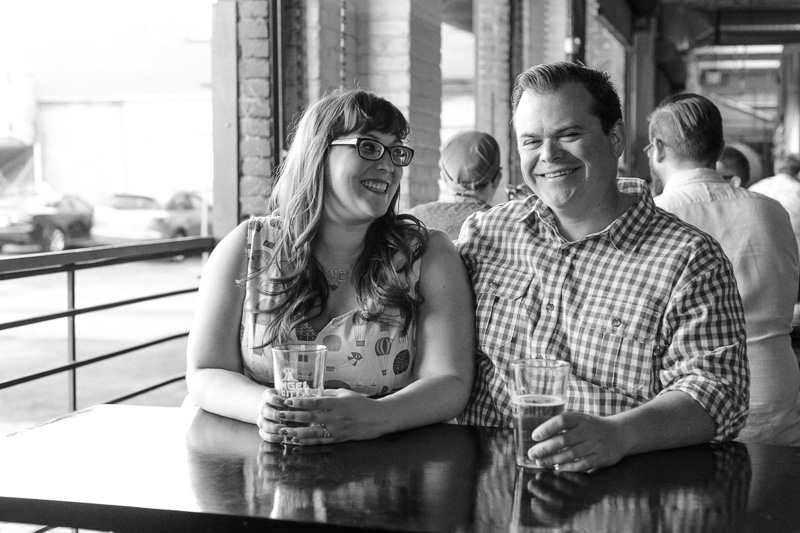 couple drinking craft beer for engagement photos at Angel City Brewery DTLA